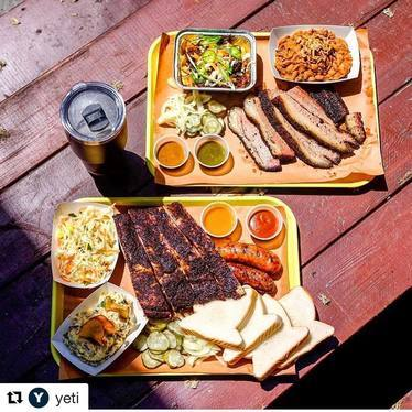 Barbecue plate with beans, sausage, slaw, bread, and pickles at Smoke Signals Barbecue