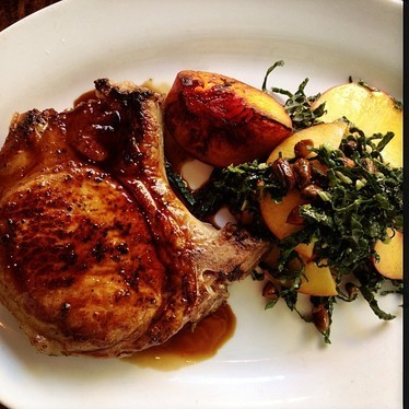 Pork chop with peaches and kale at Ford's Filling Station - LAX Delta