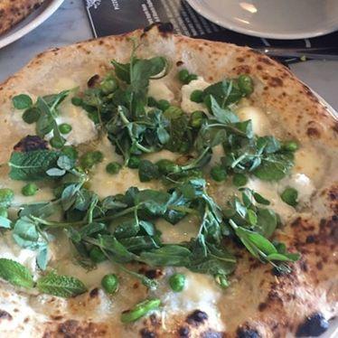 White pizza with arugula at Pizzeria Locale