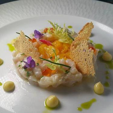 Bass tartare with Branzino, orange, bergamot vinaigrette, chives, and lemon pudding at St. Regis Bal Harbour Resort