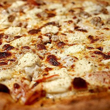 Pepperoni & onion pizza at Coal Vines