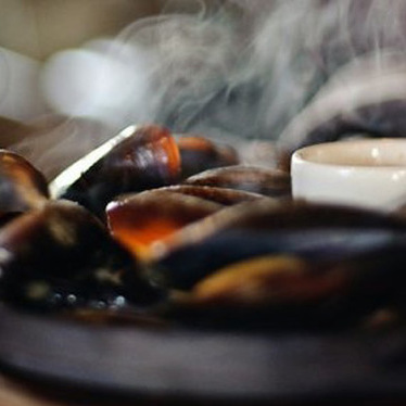 Wood fired iron skillet mussels at Firehouse Restaurant