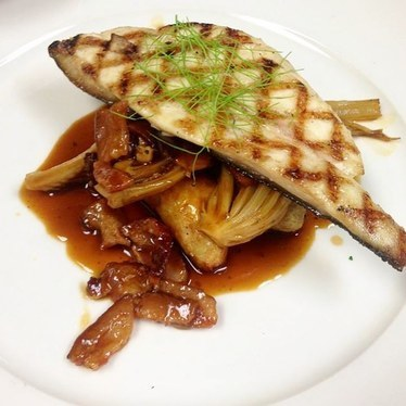 Pompano with braised fennel, celery, bacon, garlic, and fingerling potatoes at GW Fins