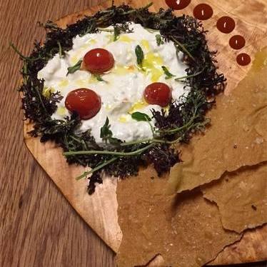 Stracciatella, cherry tomato confit, red mustard greens, pan carasau at LaRina Pastificio & Vino