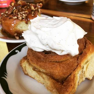 Cinnamon roll with cream cheese frosting at Milktooth