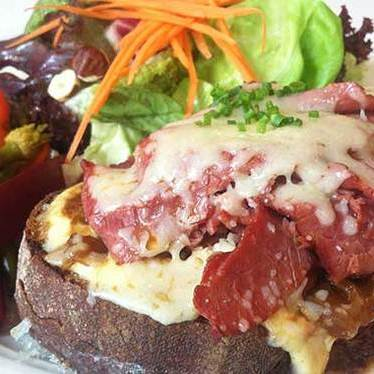 Open-faced sandwich of house-made pastrami at Higgins Restaurant & Bar