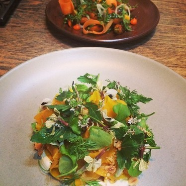 Golden beetroot, edible flowers, dill and greens at Central Kitchen