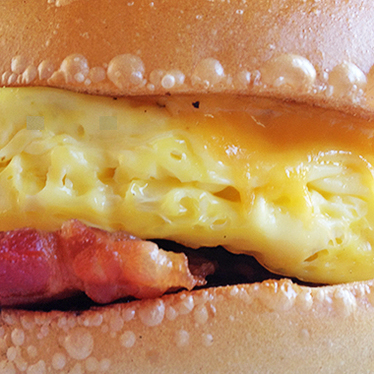 Bacon, egg, & cheese on a hard roll at Best Price Deli & Grocery
