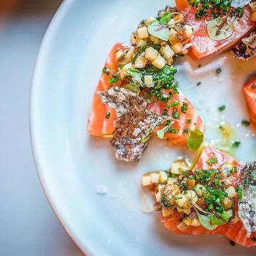 Salmon with chestnut, apple, calabrians, and salty honey at Alden & Harlow