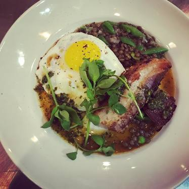 Pork belly soup with fried egg, lentils, and spring greens at Locanda