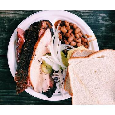 Barbecue plate with beans, pickles, and white bread at Franklin Barbecue