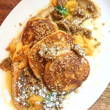 Corn pancakes, whipped coffee nougat, steel-cut granola and orange preserves at Alden & Harlow