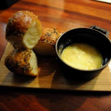 Rolls and raclette  at CHARCUT Roast House