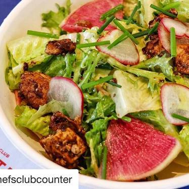 Mixed greens, radishes and spicy tofu at Chefs Club by Food & Wine