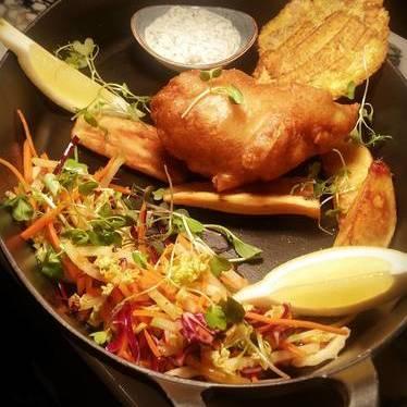 Fish and chips with cod, yuca, potato, patacon, curtido, salsa tartara and lemon at Baro