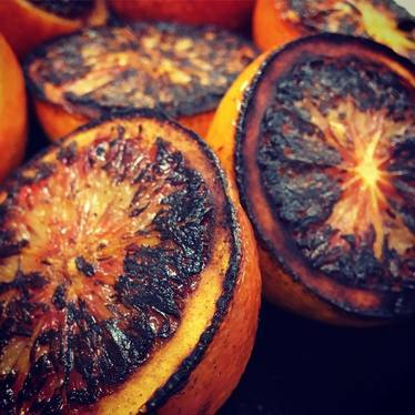 Caramelized blood oranges on their way to becoming a vinaigrette. at Local 360