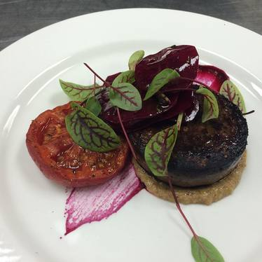 Blood pudding, slow-roasted beefsteak tomatoes, marinated beets, walnut aillade at Vie Restaurant