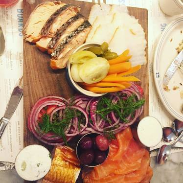 Smoked fish plate with pickles and onions at Russ & Daughters Café