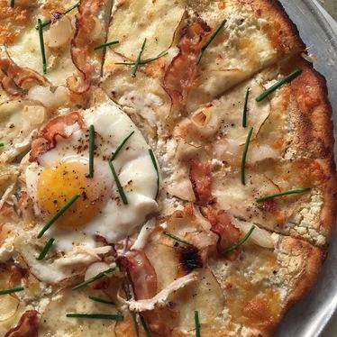 Bacon, egg, potato, ricotta, & Parmesan pizza at Mondo