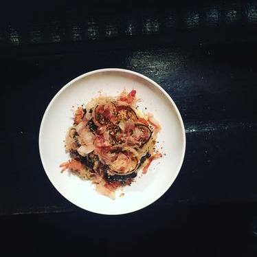 Octopus with coconut milk grits, black garlic, burnt onion and bonito at Eating House