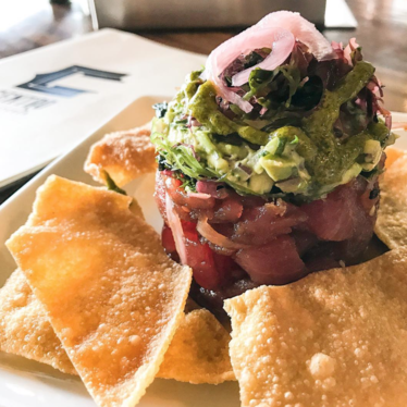 fresh ahi, house ponzu, sesame, veggies, avo relish, and crispy wontons! at Centro Bar & Kitchen