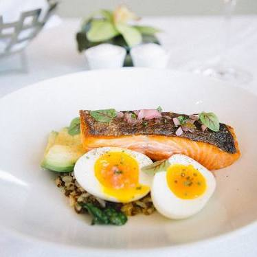 Salmon with quinoa, brown rice, and egg at Luce