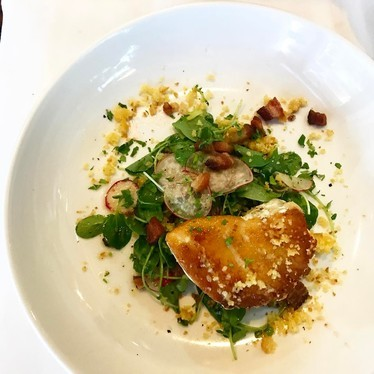 Wreckfish with watercress, radishes, cornbread crumbs, and bacon at Cafe Margot