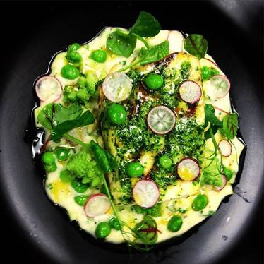 Grilled sea bass, English peas, Romanesco, truffle potato, leek fondue, shaved radishes at STK Rooftop