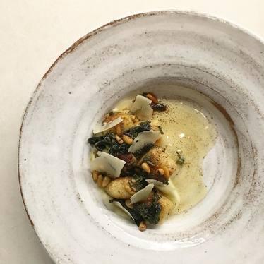 Ricotta dumplings, cauliflower, butter, black trumpet, and pine nuts at Aster