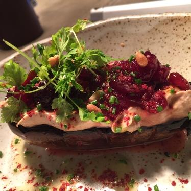 Charred eggplant, black garlic tahini, cherries at Butcher & Bee