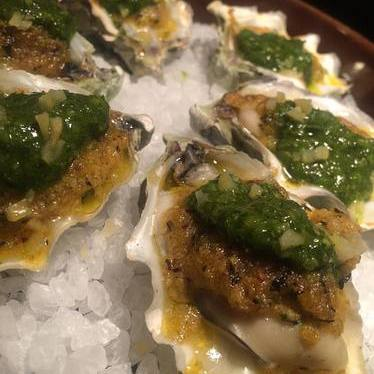 Oysters with squash butter, mint chimi churri, and preserved lemons  at Tiger!Tiger!