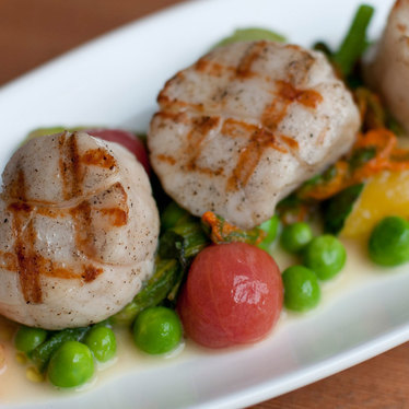 Seared scallops at How To Cook A Wolf