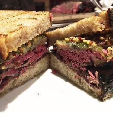 Pastrami sandwich with pickles and whole grain mustard at The Lambs Club