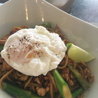 Poached egg on asparagus lo mein at Myers + Chang