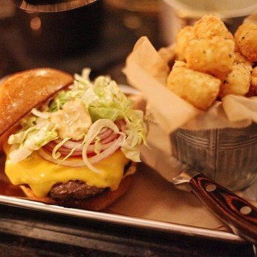 Old fashioned cheese burger with tater tots at The Douglas Room