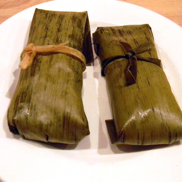 Chicken mole poblano tamales in banana leaf at El Molino Central