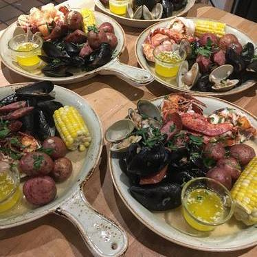 Lobster boils with corn on the cob, potatoes and clams at The Hourly