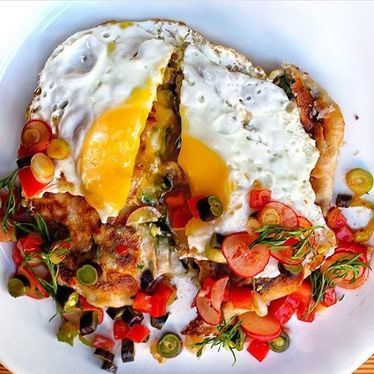 Mad hatter pie with fried egg, cranberry beans, cheese, pico de gallo and avocado  at NIX