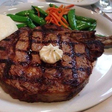 Bone-in ribeye at Harris' Restaurant