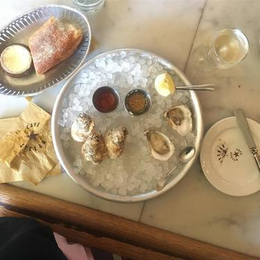 Oysters, rosé, jamon, charcuterie, pickles and cheese at Cafe Stella