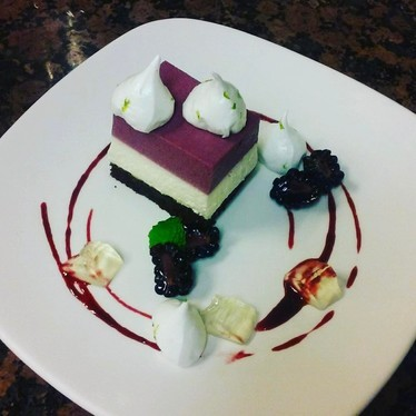 Chocolate cake with mint cream and blackberries at Commander's Palace
