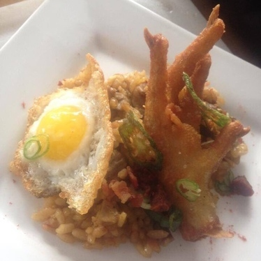 Puffed rice with a chicken fried chicken foot and a quail egg. at Tatu's Food Debauchery