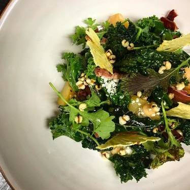 Brassicas, pineapple quince, pineapple, jamon, cotija, and barley at George's At The Cove