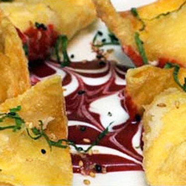 Goat cheese wontons & raspberry basil sauce at Todd's Unique Dining