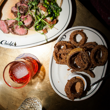 Grilled beef shoulder with onion rings and a cognac cocktail at The Carlile Room