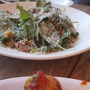 Kale salad and chicken at King + Duke