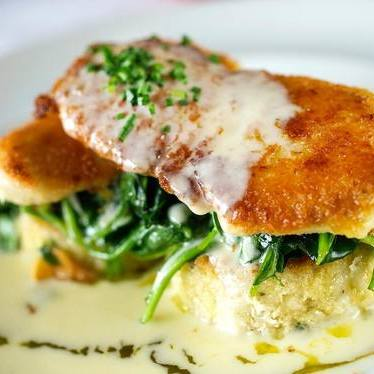 Parmigiano reggiano crusted Alaskan halibut at John Howie Steak