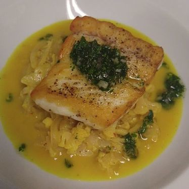 Pan-roasted halibut, cauliflower, white wine, curry, verjus, tarragon at Cafe Campagne