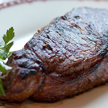 Broiled strip loin steak bone-In at Gene & Georgetti