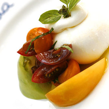 Burrata w/ organic tomato salad at Casa Tua Restaurant